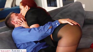 Alight red haired woman Kelly Divine gets her pussy fucked in ripped pantyhose