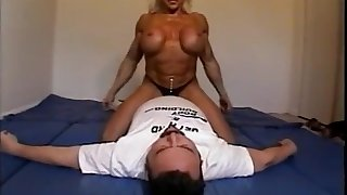 Denude female bodybuilder dominates male with scissors, facesits, bore smothers and breast
