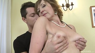Lay mature Dana in stockings gets fucked by a younger man