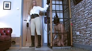 Submissive on a produce lead on licks dirty boots of sexy mistress Dommelia
